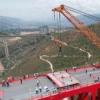 中老铁路中国段玉磨铁路的元江双线特大桥顺利实现合龙